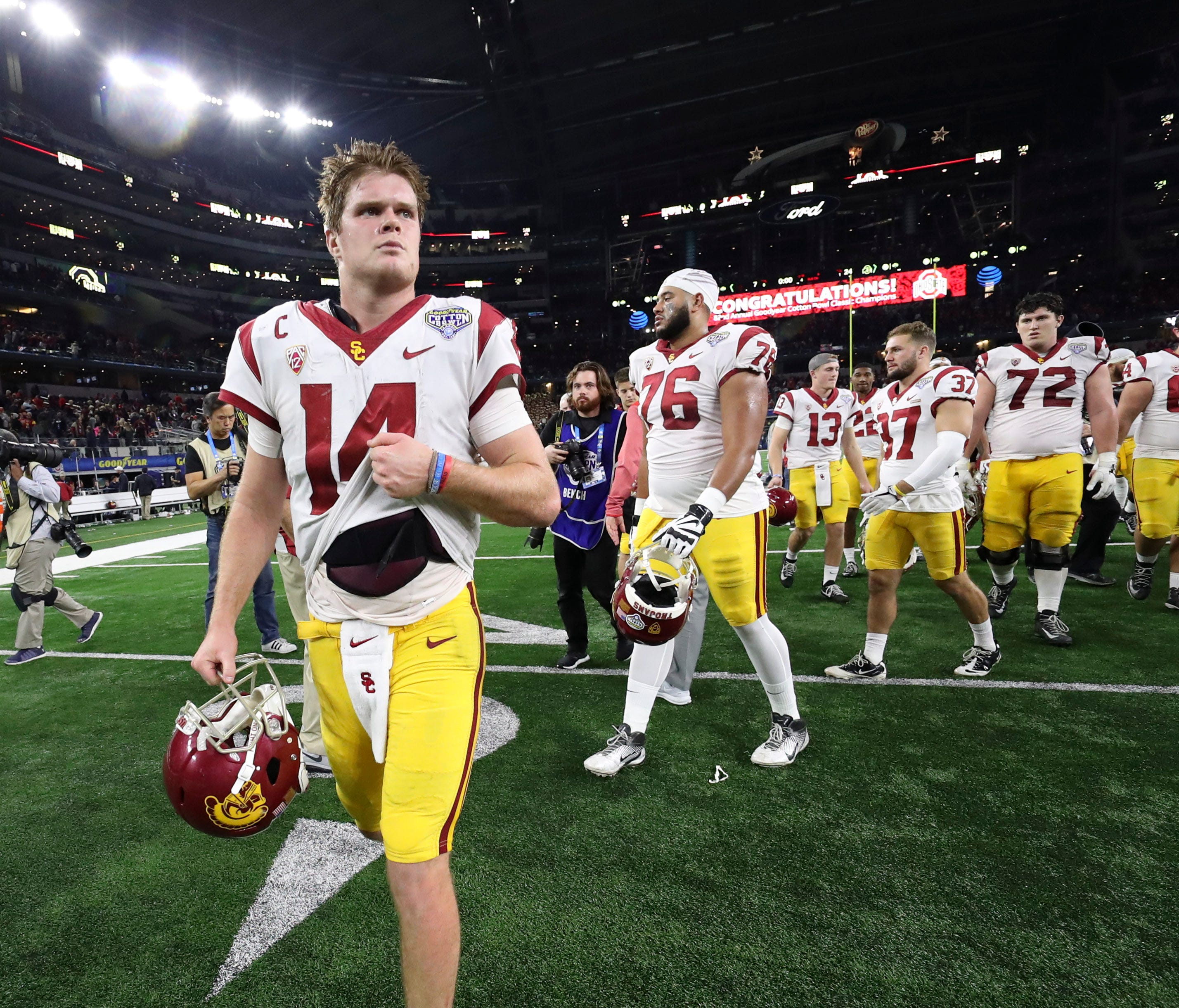 Quarterback Sam Darnold and the USC Trojans depart after losing to Ohio State in the Cotton Bowl.