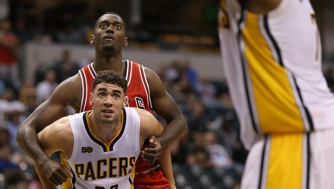 Pacers forward Georges Niang (32) boxes out Bulls forward Bobby Portis during a preseason game.