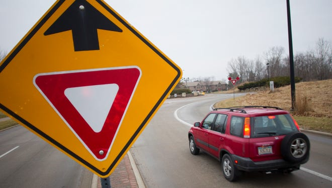 A car passes through the roundabout in Coralville. Cedar Falls will soon add a two-lane roundabout on University Ave. and wants to educate drivers.