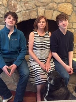 Following a massive stroke and an emergency cerebral angiogram, Janis Blackburn now is back to enjoying life with her twin 15-year-old grandsons, Jonathan (left) and Michael.