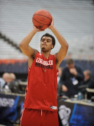 Louisville's Quentin Snider gets off a shot during practice prior to Friday's NCAA game against North Carolina State.  March 26, 2015.