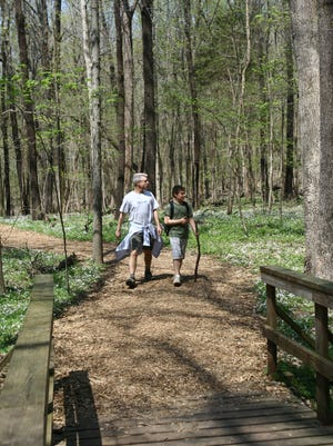 Bill Romf and his son Nick hike Radnor Lake's trails during a visit to family here in Nashville.