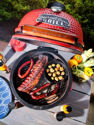 Reyer Farms pork sausage, Sugar Taylor ribs, and twice-smoked stuffed mushrooms, all cooked on a Gourmet Guru Grill.