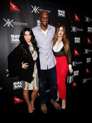 Lamar Odom with Kim and Khloe Kardashian in 2011.