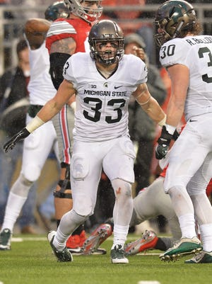Jon Reschke of the Michigan State Spartans celebrates after sacking quarterback J.T. Barrett of the Ohio State Buckeyes in the second quarter at Ohio Stadium on Nov. 21, 2015.