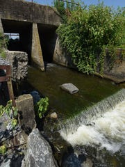 The spillway at Hearns Pond Dam, which has been damaged several times in the past 20 years, will be restored as part of a new program to prevent dam failures.