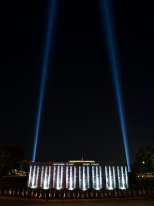 Blue lights extend to the sky as part of a 9/11 memorial at Bob Jones University on Thursday, September 8, 2016.