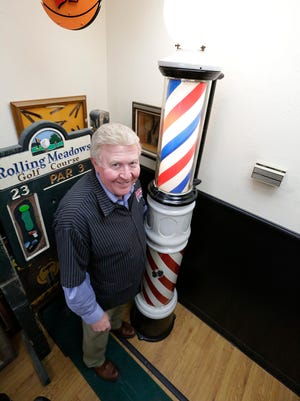 """Fond du Lac barber Red Mullenbach stands next to an antique barber pole he picked up at the """"American Pickers"""" shop in LeClaire, Iowa. Central Barber is located at 4 N. Main St. in Fond du Lac."""