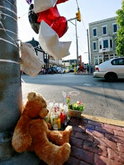 A makeshift memorial lies in the foreground while Black Ministers Association of York and York City pastors join together with community members to pray to end gun violence at the intersection of West Princess Street and Belvidere Avenue in York City, Monday, July 3, 2017. The memorial is a tribute to York City resident Elizabeth Vega-Tirado, 48, who was was shot at the intersection on June 27 and later died. Vega-Tirado was not the intended target. Dawn J. Sagert photo
