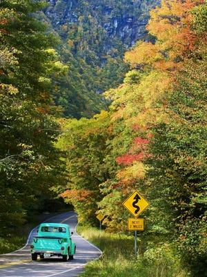 A pickup heads up Smugglers Notch from Stowe in this photo from an earlier foliage season.