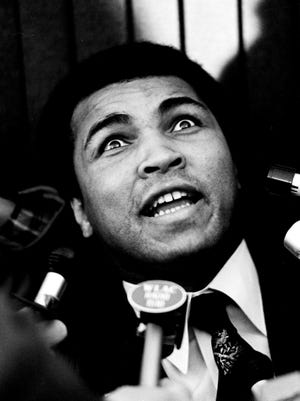 """The colorful Muhammad Ali holds court during a press conference at Municipal Auditorium on Dec. 16, 1977, after arriving here for the premiere of """"Wilma."""""""