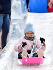 Aajahila James, 6, of York City, sleds down the ice