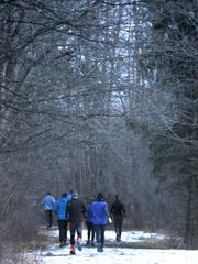 Eight people take off through the Lapham Peak Unit of the Kettle Moraine State Forest for a Wednesday evening run by the Lapham Peak Trail Runners on Jan. 31. Some will run the Ice Age Trail to Lapham Peak's southern border while other will stick to trails leading up to Lapham Peak.