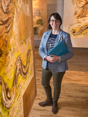 Director Amy Bowman-McElhone poses among the work of artist Katrina Andry at the Pensacola Museum of Art on Wednesday, February 28, 2018.