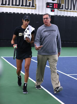 Vanderbilt senior Astra Sharma talks with tennis coach Geoff Macdonald. The Commodores are the No. 1 seed in this week's SEC tournament in Knoxville.