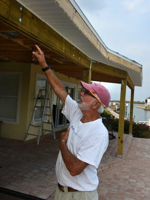 Rob Reiley points out where damage occurred due to shoddy workmanship by his repair company. Marco Island police are conducting an investigation into the operations of one contractor who generated numerous complaints for their post-Irma repair work.