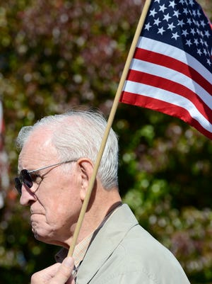 Army veteran Oscar Larson, 79, of Mountain Home, salutes during Veterans Day ceremonies last year at the Mountain Home Plaza. Nearly 1,000 people attended the event.