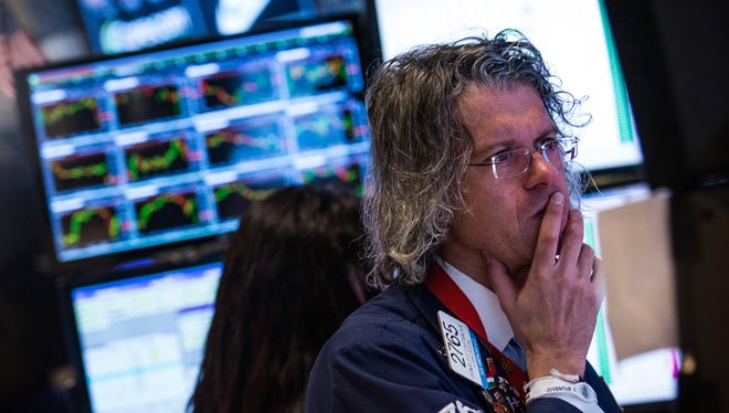 A trader works on the floor of the New York Stock Exchange on March 3, 2014 in New York City.