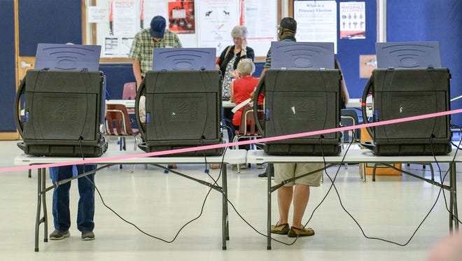 People vote at Centerville Elementary School precinct during state primaries in Anderson on Tuesday, June 12, 2018.