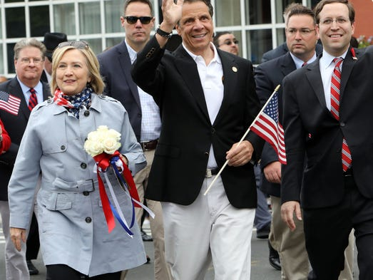 Hillary Clinton and Gov. Andrew Cuomo march in the
