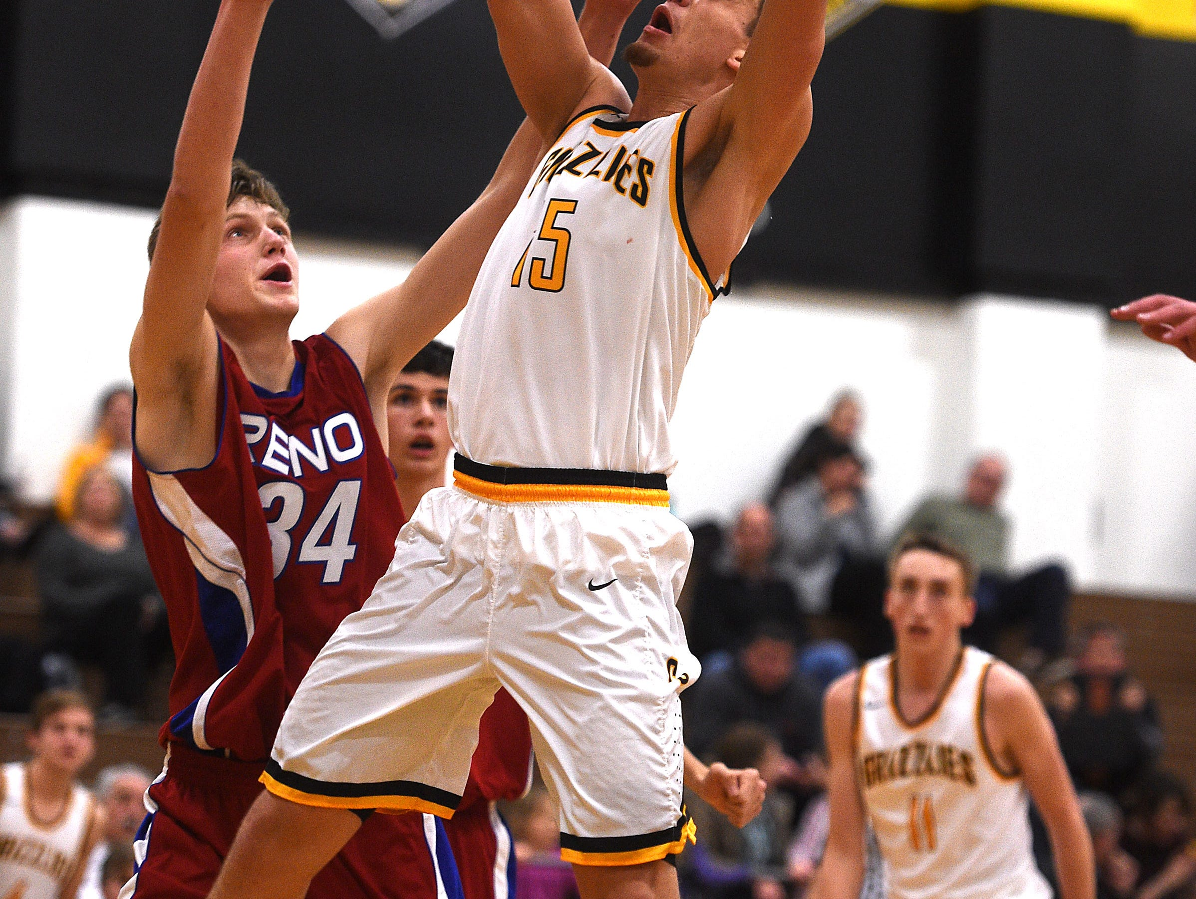 Galena's Dillon Voyles (15) shoots over Reno's Tommy Challis (34) during their basketball game on Jan. 3, 2017.