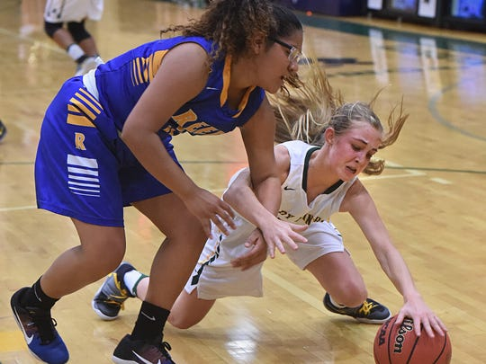 Bishop Manogue's Kenna Holt reaches for the ball she knocked away from Reed's Autumn Wadsworth during the first half at Bishop Manogue High School on Dec. 6, 2016. Bishop Manogue defeated Reed 54-44