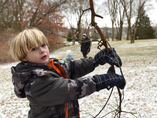 Corbin Fear finds a branch while at Milford's Fairgrounds
