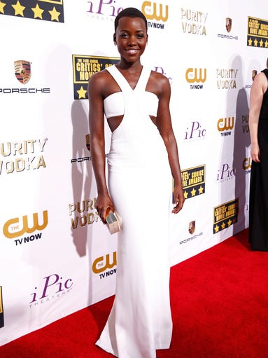 Lupita Nyong'o, nominated for best supporting actress for '12 Years a Slave,' is radiant on the red carpet at the 19th Annual Critics' Choice Movie Awards.