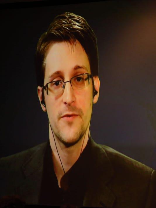 Edward Snowden, Sundar Pichai back Apple in fight over iPhone