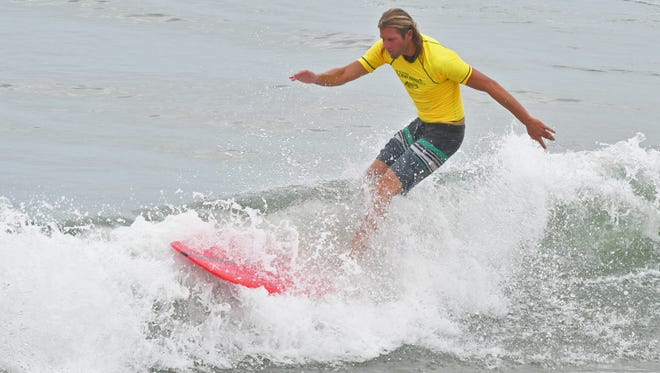 Sunday at the NKF  (National Kidney Foundation) Rich Salick Pro-Am Surf Festival at the Cocoa Beach Pier.