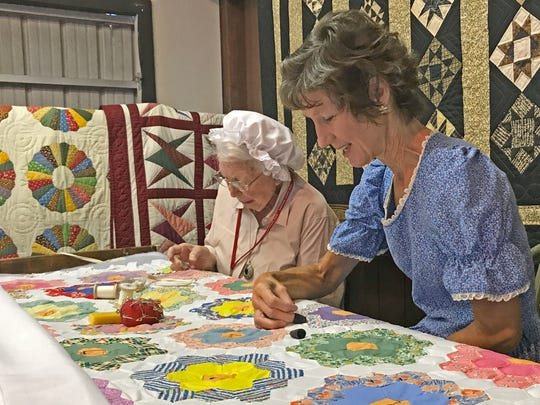 Quilting is featured in the Pioneer Farm Building.
