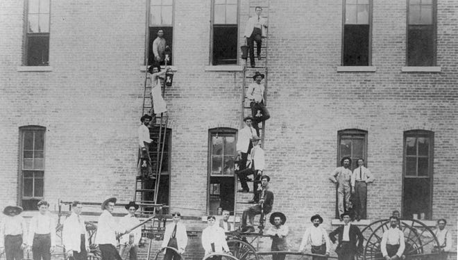The El Paso volunteer fire department demonstrates bucket lines at the Grand Central Hotel in 1884 or 1885.