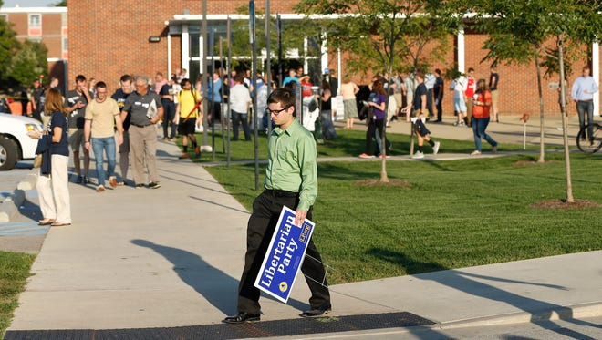 People file out of the co-rec following Libertarian Presidential Candidate Gary Johnson's  addresses talk with Purdue President Mitch Daniels Tuesday, September 13, 2016, in West Lafayette.