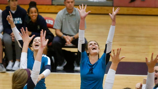 Siegel's Annie Walden (1) and Makenzie Jordan (4) celebrate winning a point against Oakland with their team during a match on Thursday, Sept. 7, 2017, at Oakland.