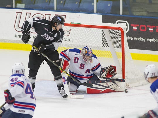 Kicking aside a Fargo shot Saturday for the NTDP U17s is goalie Dylan St. Cyr (No. 33).