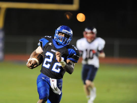 Presbyterian Christian running back Isaiah Woullard (22) runs the ball for a touchdown against Lamar School on Friday at PCS.