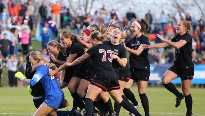 Goalkeeper Casey Murphy (blue) starred in the shootout as Rutgers upset Virginia to advance to its first Final Four.
