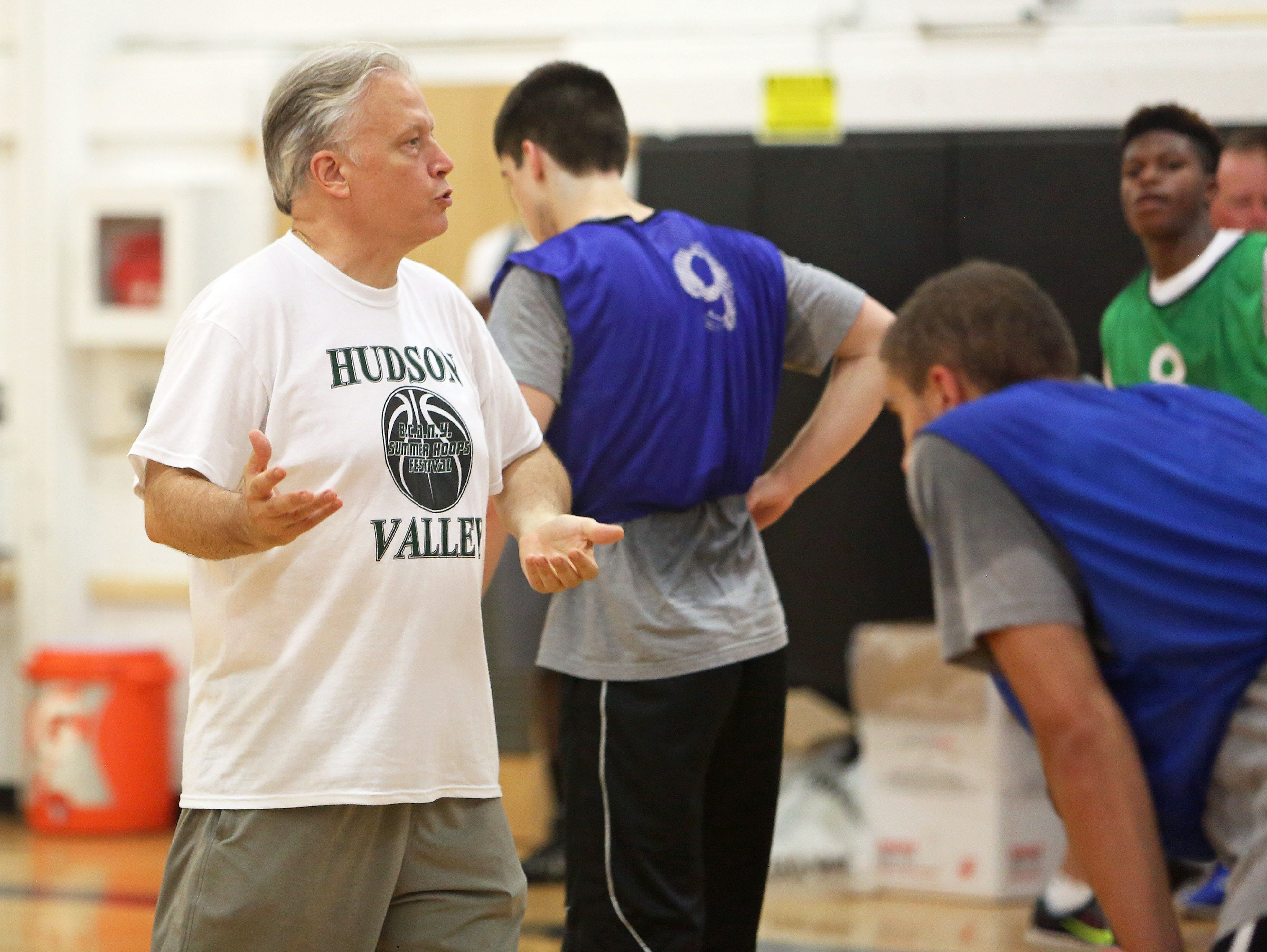 Coach Bill Thom conducts practice with the Hudson Valley team at Croton High School July 29, 2015. The team is preparing for the BCANY Summer Hoops Festival.