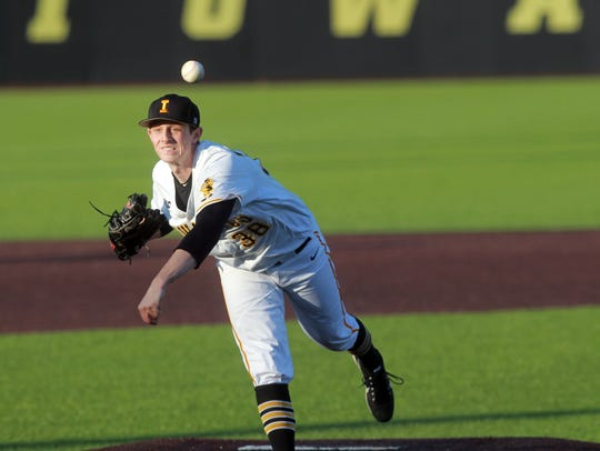 Iowa's Trenton Wallace delivers a pitch during the