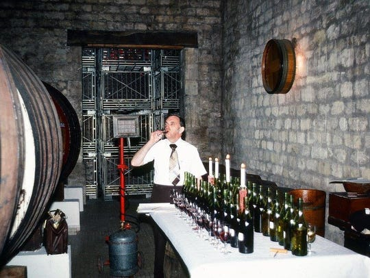 Sherwood Deutsch tasting wine in a Burgundy Cellar.
