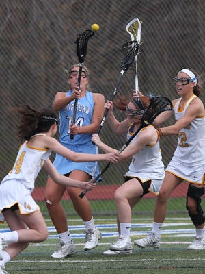 Suffern's Reilly Drab (14) gets off a shot while surrounded by Mahopac's defenders during girls lacrosse action at Mahopac High School April 20,  2017. Suffern won the game 14-6.