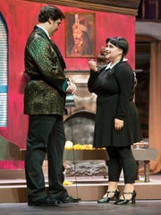 Austin Rowe as Gomez and Liz Watson as Wednesday perform