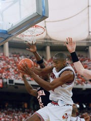 Clifford Rozier (44) grabs a rebound from Oklahoma State's Fred Burley during a 1993 game.