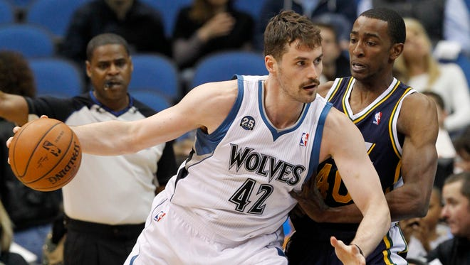 FILE - In this April 16, 2014 file photo, Minnesota Timberwolves forward Kevin Love (42) drives against Utah Jazz forward Jeremy Evans.