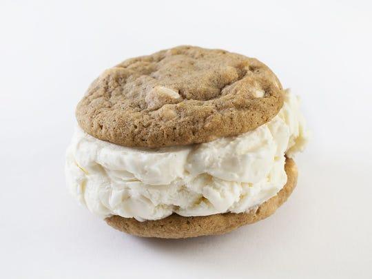 Craft an ice cream sandwich with pumpkin spice cookies,
