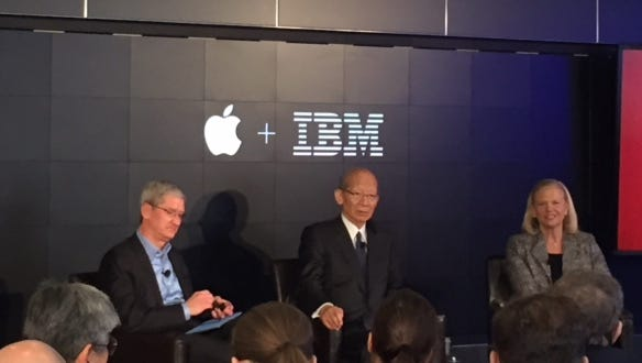 Apple's Tim Cook, Japan Post's Taizo Nishimuro and IBM's Ginni Rometty