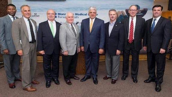 Tyrone Garrett, Adam Schneider, Pasquale Menna, Gerald Tarantolo, Frank J. Vozos, Michael Mahon, Robert Neff Jr. and Bill Arnold.