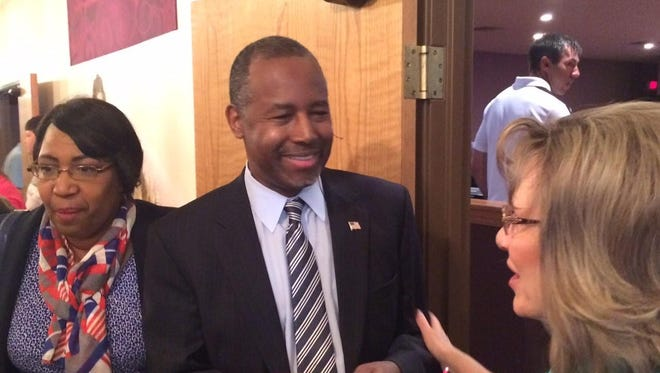 Ben Carson greets Osceola resident Becky Oehlert, who received an autograph from the Republican presidential candidate Sunday after the morning service at LifePoint Assembly of God church.
