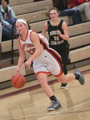 Lucas' Jessie Grover dribbles down the court during