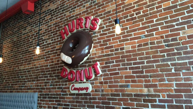A Hurts Donut Company logo on display inside the downtown Springfield location is shown in this 2015 News-Leader file photo.